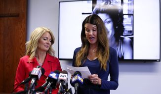 Model Janice Dickinson, right, speaks at a press conference, Thursday, July 25, 2019, in Los Angeles, announcing a settlement of her defamation lawsuit against comedian Bill Cosby. The deal allows Dickinson to continue to speak out against Cosby. Looking on at left is Dickinson's attorney Lisa Bloom. (AP Photo/Katherine Campione)