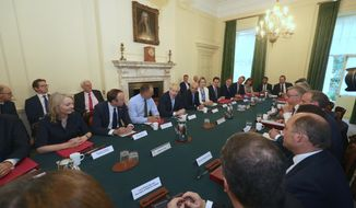 Britain's Prime Minister Boris Johnson, centre, holds his first Cabinet meeting as prime minister on Thursday July 25, 2019, pledging to break the Brexit impasse that brought down his predecessor Theresa May.  Cabinet members seated at table from left, International Trade Secretary Liz Truss, Health and Social Care Secretary Matt Hancock, Cabinet Secretary Mark Sedwill, Prime Minister Boris Johnson, Chancellor of the Exchequer Sajid Javid, Works and Pensions Secretary and Minister for Women Amber Rudd, Housing, Communities and Local Government Secretary Robert Jenrick, Transport Secretary Grant Shapps, Scottish Secretary Alister Jack, Culture Scretary Nicky Morgan, Chief Secretary to the Treasury Rishi Sunak, and Chief Whip Mark Spencer. (Aaron Chown/Pool via AP)