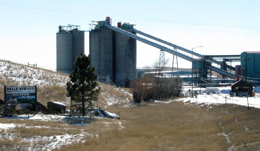 In a Jan. 21, 2016, file photo, the Belle Ayr Mine stands near Gillette, Wyo. Two coal mines in Wyoming and one in West Virginia owned by a company in bankruptcy could reopen if a judge approves a purchase offer. Court documents show Bristol, Tennessee-based Contura Energy has offered $20.6 million for the mines owned by Milton, West Viginia-based Blackjewel LLC. The mines have been closed since Blackjewel filed for bankruptcy July 1, 2019. (AP Photo/Mead Gruver, File) **FILE**