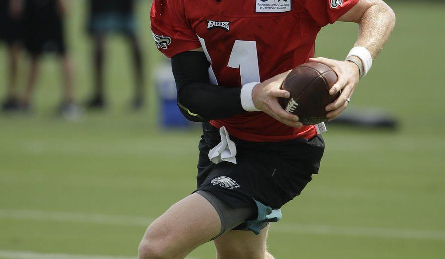Philadelphia Eagles quarterback Carson Wentz runs a drill during practice at the NFL football team's training camp in Philadelphia, Thursday, July 25, 2019. (AP Photo/Matt Rourke)