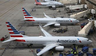 This Wednesday, July 17, 2019 photo shows American Airlines planes at Phoenix Sky Harbor International Airport in Phoenix. American Airlines, Inc. reports earnings Thursday, July 25. (AP Photo/Ross D. Franklin)