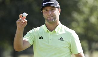 Jon Rahm, of Spain, acknowledges the applause as he leaves the ninth green during the first round of the World Golf Championships-FedEx St. Jude Invitational Thursday, July 25, 2019, in Memphis, Tenn. (AP Photo/Mark Humphrey)