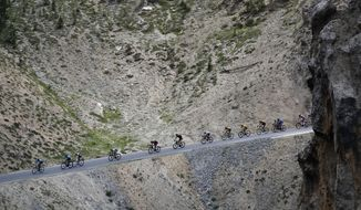 The pack rides during the eighteenth stage of the Tour de France cycling race over 208 kilometers (130 miles) with start in Embrun and finish in Valloire, France, Thursday, July 25, 2019. (AP Photo/ Christophe Ena)