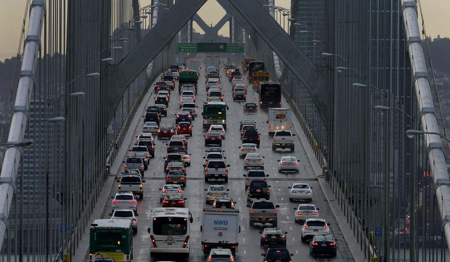 In this Dec. 10, 2015, file photo, vehicles make their way westbound on Interstate 80 across the San Francisco-Oakland Bay Bridge as seen from Treasure Island in San Francisco. (AP Photo/Ben Margot, File)
