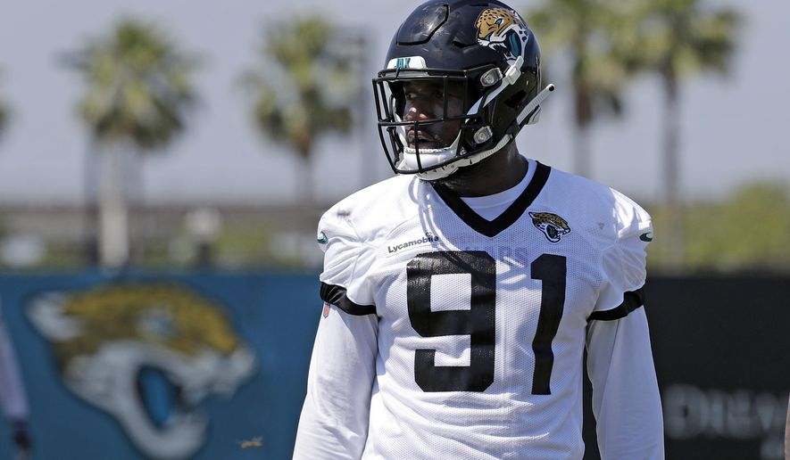 fba9b3a0 Ngakoue ends holdout, reports to Jags camp without new deal ...