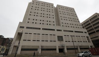 This Feb. 20, 2019 file photo, shows the exterior of the Cuyahoga County Corrections Center in Cleveland. A memo obtained by The Associated Press shows a recent state inspection of the troubled county jail has found problems with medical care and other issues persist months after they were cited during previous inspections.  (AP Photo/Tony Dejak, File)