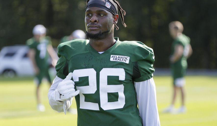 New York Jets running back Le'Veon Bell participates in a practice at the NFL football team's training camp in Florham Park, N.J., Thursday, July 25, 2019. (AP Photo/Seth Wenig)