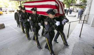 New York City Police Dept. officers carry the casket of Robert Morgenthau, ex-prosecutor and Manhattan's longest-serving DA who inspired a 'Law & Order' character, into Temple Emanu-El, Thursday, July 25, 2019, in New York. (AP Photo/Richard Drew)