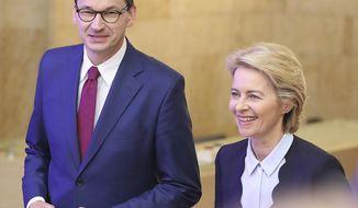 Ursula von der Leyen, right, designated European Commission President, and Poland's Prime Minister Mateusz Morawiecki arrive for a news conference in Warsaw, Poland, Thursday, July 25, 2019.(AP Photo/Czarek Sokolowski)