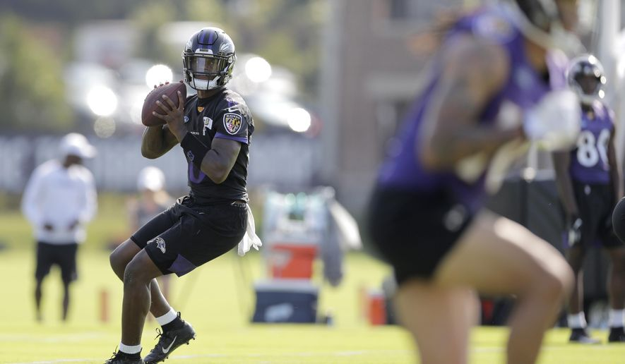 Baltimore Ravens quarterback Lamar Jackson works out during NFL football training camp, Thursday, July 25, 2019, in Owings Mills, Md. (AP Photo/Julio Cortez) ** FILE **