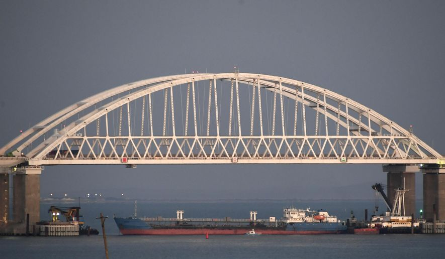 FILE - In this file photo taken on Sunday, Nov. 25, 2018, a Russian tanker under the the Kerch bridge blocks the passage to the Kerch Strait near Kerch, Crimea. The Ukrainian Security Service (SBU) said in a statement Thursday July 25, 2019, that it has seized the Russian tanker moored in a Ukrainian Black Sea port. (AP Photo)