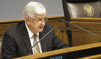 FILE - In this May 12, 2016, file photo, Senate President John Alario, R-Westwego, asks questions during a meeting of the state's income forecasting panel in Baton Rouge, La. Alario, who has been a fixture in state politics for five decades, says he's leaving the Legislature at the end of this term. (AP Photo/Melinda Deslatte, File)