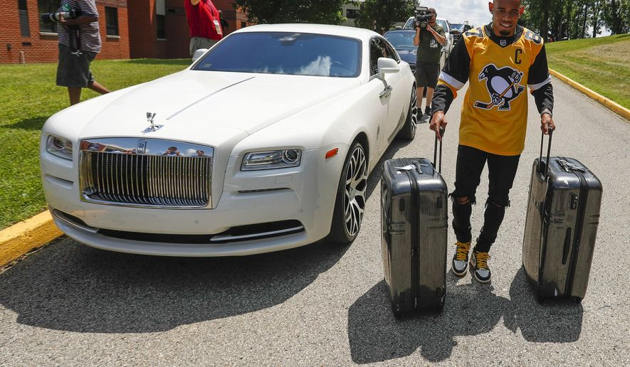 Pittsburgh Steelers cornerback Joe Haden rolls suitcases past his car as he arrives for NFL football training camp in Latrobe, Pa., Thursday, July 25, 2019. (AP Photo/Keith Srakocic)