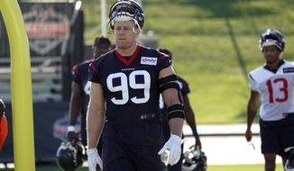 Houston Texans defensive end J.J. Watt (99) walks across the field before an NFL football training camp practice Thursday, July 25, 2019, in Houston. Watt is on the physically unable to perform list. (AP Photo/David J. Phillip)