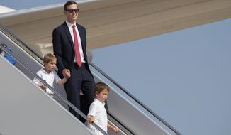 White House senior adviser Jared Kushner and his children Theodore Kushner, left, and Joseph Kushner, right, disembark Air Force One at Andrews Air Force Base, Md., Sunday, July 21, 2019. (AP Photo/Manuel Balce Ceneta)