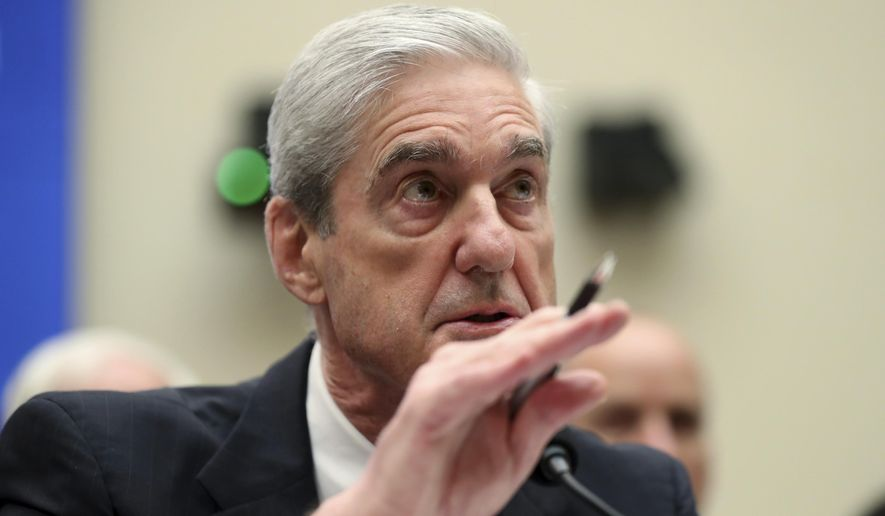 In this file photo, former special counsel Robert Mueller testifies before the House Intelligence Committee hearing on his report on Russian election interference, on Capitol Hill, in Washington, Wednesday, July 24, 2019. (AP Photo/Andrew Harnik)   **FILE**