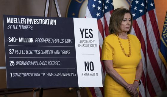 Speaker of the House Nancy Pelosi, D-Calif., stands beside a chart during a newss conference following the back-to-back hearings with former special counsel Robert Mueller who testified about his investigation into Russian interference in the 2016 election, on Capitol Hill in Washington, Wednesday, July 24, 2019. (AP Photo/J. Scott Applewhite) **FILE**