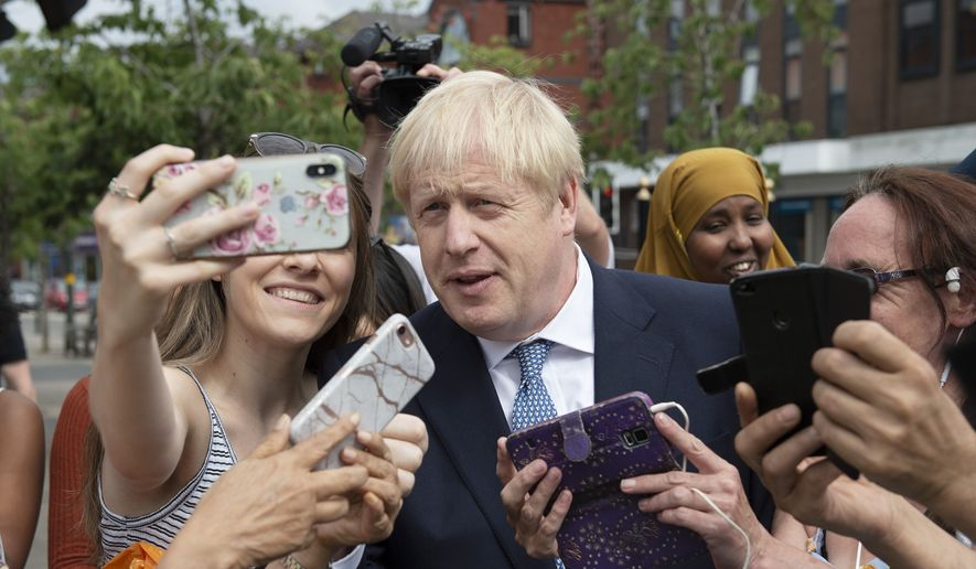 Britain's Prime Minister Boris Johnson on a walkabout during a visit to North Road, Birmingham, England, Friday, July 26, 2019. (Geoff Pugh/Pool Photo via AP)