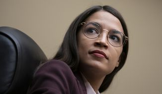 Rep. Alexandria Ocasio-Cortez, D-N.Y., attends a House Oversight Committee hearing on high prescription drugs prices shortly after her private meeting with Speaker of the House Nancy Pelosi, D-Calif., on Capitol Hill in Washington, Friday, July 26, 2019. The high-profile freshman and the veteran Pelosi have been critical of one another recently. (AP Photo/J. Scott Applewhite) **FILE**
