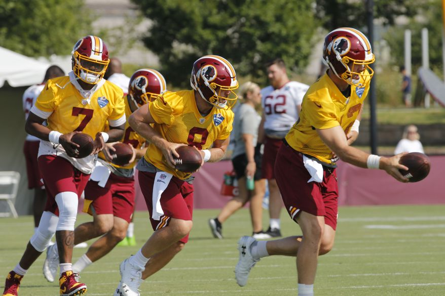 Washington Redskins quarterbacks Colt McCoy (12), Case Keenum (8) and Dwayne Haskins Jr., (7) run drills during the NFL football training camp in Richmond, Va., Friday, July 26, 2019. (AP Photo/Steve Helber)
