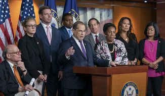 House Judiciary Committee Chairman Jerrold Nadler, D-N.Y., center, and Democratic members of that panel, speak to reporters about this week's testimony from former special counsel Robert Mueller and their plan to continue to investigate President Donald Trump and Russia's interference in the election, at the Capitol in Washington, Friday, July 26, 2019. Nadler says they are seeking enforcement of a subpoena against former White House counsel Donald McGahn, a key Mueller witness. (AP Photo/J. Scott Applewhite)