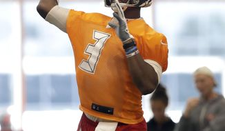 Tampa Bay Buccaneers quarterback Jameis Winston (3) throws a pass during an NFL football training camp practice Friday, July 26, 2019, in Tampa, Fla. (AP Photo/Chris O'Meara)
