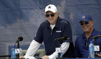 """Dallas Cowboys owner Jerry Jones, left, and Executive Vice President Stephen Jones smile during the """"state of the team"""" press conference at the start of the Dallas Cowboys NFL football training camp Friday, July 26, 2019, in Oxnard, Calif. (AP Photo/Marcio Jose Sanchez)"""