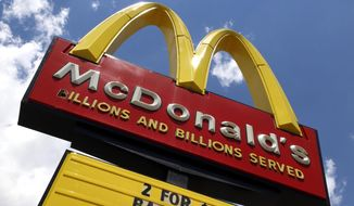 In this June 25, 2019 photo a sign is displayed outside a McDonald's restaurant in Pittsburgh. McDonald's Corp. reports financial earnings on Friday, July 26. (AP Photo/Gene J. Puskar)