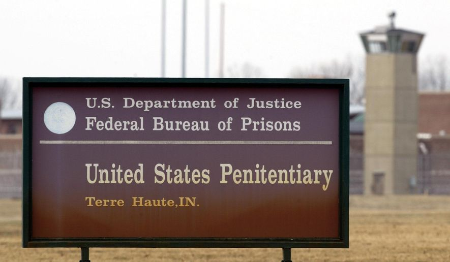 In this March 17, 2003, photo, the guard tower flanks the sign at the entrance to the U.S. Penitentiary in Terre Haute, Ind., the site of the last federal execution. The Justice Department says it will carry out executions of federal death row inmates for the first time since 2003. (AP Photo/Michael Conroy) **FILE**