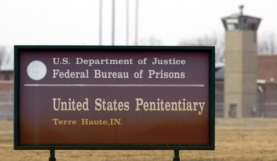 In this March 17, 2003, photo, the guard tower flanks the sign at the entrance to the U.S. Penitentiary in Terre Haute, Ind. (AP Photo/Michael Conroy) **FILE**