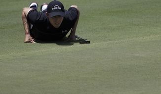 Matthew Fitzpatrick, of England, views his putt on the seventh green during the second round of the World Golf Championships-FedEx St. Jude Invitational Friday, July 26, 2019, in Memphis, Tenn. (AP Photo/Mark Humphrey)