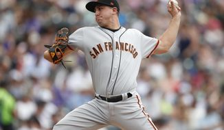 San Francisco Giants relief pitcher Derek Holland works against the Colorado Rockies in the fifth inning of a baseball game Wednesday, July 17, 2019, in Denver. (AP Photo/David Zalubowski)