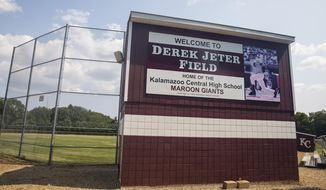 This July 25, 2019 photo shows Derek Jeter Field at Kalamazoo Central High School in Kalamazoo, Mich. A charitable organization founded by the former New York Yankees shortstop is donating about $3.2 million to renovate a baseball and softball complex at his Michigan high school. The Kalamazoo Public Schools district announced the donation Thursday, July 25  from the Turn 2 Foundation.  (Joel Bissell /Kalamazoo Gazette via AP)