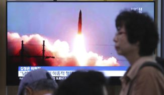 """A TV screen shows an image of North Korea's missile launch during a news program at the Seoul Railway Station in Seoul, South Korea, Friday, July 26, 2019. A day after two North Korean missile launches rattled Asia, the nation said Friday it had tested a """"new-type tactical guided weapon"""" that was meant as a """"solemn warning"""" about South Korean weapons development and its plan to hold military exercises. (AP Photo/Ahn Young-joon)"""