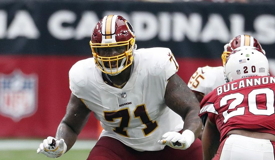 In this Sept. 9, 2018, file photo, Washington Redskins offensive tackle Trent Williams (71) is shown in action during an NFL football game against the Arizona Cardinals, in Glendale, Ariz. Fans worry that the summer rite in the NFL, training camp holdouts, won't affect their team's chances for a championship. This year's crop of no-shows includes an All-Pro receiver, the Saints' Michael Thomas; a standout offensive tackle who might be the key to the Redskins' offense, Trent Williams; and budding stars DEs Jadeveon Clowney of the Texans, Yannick Ngakoue of the Jaguars, and RB Melvin Gordon of the Chargers. (AP Photo/Rick Scuteri, File) **FILE**