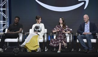 """Gary Carr, from left, Anne Hathaway, Cristin Milioti and Daniel Jones participate in the Amazon Prime Video """"Modern Love"""" panel at the Television Critics Association Summer Press Tour on Saturday, July 27, 2019, in Beverly Hills, Calif. (Photo by Richard Shotwell/Invision/AP)"""