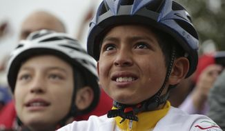 Tears run down the face of a boy watching on a giant screen Colombia's Egan Bernal performance in the twentieth stage of the Tour de France cycling race Bernal's hometown in Zipaquira, Colombia, Saturday, July 27, 2019. Bernal put on the overall leader's yellow jersey after the stage, and barring a crash or a last-minute health issue will become the first Colombian to win the cycling's biggest race when the Tour ends on Paris' Champs-Elysees on Sunday. (AP Photo/Ivan Valencia)(AP Photo/Ivan Valencia)