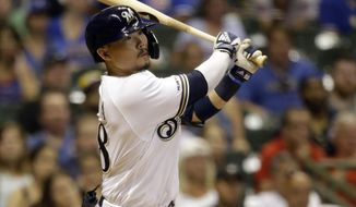 Milwaukee Brewers' Keston Hiura watches his two-run home run during the 10th inning of a baseball game against the Chicago Cubs, Saturday, July 27, 2019, in Milwaukee. (AP Photo/Jeffrey Phelps)