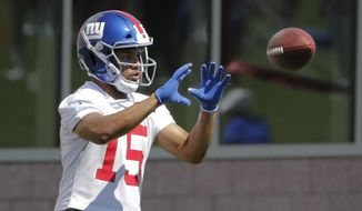 FILE - In a Tuesday, June 4, 2019 file photo, New York Giants' Golden Tate runs a drill during an NFL football minicamp at the team's training facility, in East Rutherford, N.J. Tate has been suspended for four games for using a drug prescribed for fertility planning. The 10-year veteran, who signed with the Giants in March as a free agent, announced the suspension in a Twitter post Saturday, July 27, 2019. (AP Photo/Frank Franklin II, File)