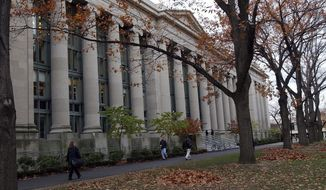 In this Nov. 19, 2002 file photo, students walk through the Harvard Law School area on the campus of Harvard University in Cambridge, Mass. (AP Photo/Chitose Suzuki, File)  **FILE**