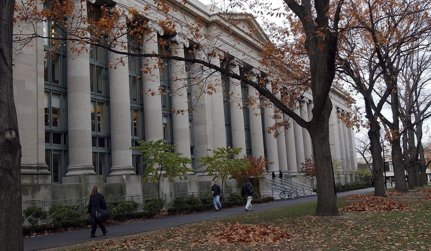In this Nov. 19, 2002 file photo, students walk through the Harvard Law School area on the campus of Harvard University in Cambridge, Mass. (AP Photo/Chitose Suzuki, File)  **FILE**