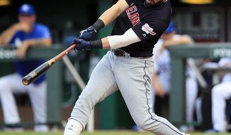 Cleveland Indians' Jason Kipnis hit a grand slam off Kansas City Royals starting pitcher Glenn Sparkman during the first inning of a baseball game at Kauffman Stadium in Kansas City, Mo., Saturday, July 27, 2019. (AP Photo/Orlin Wagner)