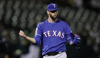 Texas Rangers pitcher Chris Martin celebrates the 5-2 win as the final out is made against the Oakland Athletics in the ninth inning of a baseball game Friday, July 26, 2019, in Oakland, Calif. (AP Photo/Ben Margot)