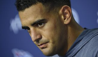 Tennessee Titans NFL football quarterback Marcus Mariota (8) talks with the media after practice at Saint Thomas Sports Park Friday, July 26, 2019, in Nashville, Tenn. (George Walker IV/The Tennessean via AP)