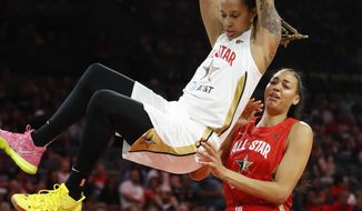 Phoenix Mercury's Brittney Griner, of Team Delle Donne, dunks over Las Vegas Aces' Liz Cambage, of Team Wilson, during the first half of a WNBA All-Star game Saturday, July 27, 2019, in Las Vegas. (AP Photo/John Locher)