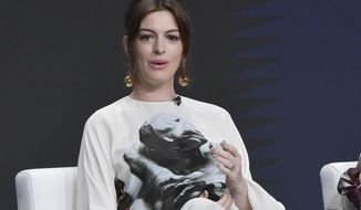 """Anne Hathaway participates in the Amazon Prime Video """"Modern Love"""" panel at the Television Critics Association Summer Press Tour on Saturday, July 27, 2019, in Beverly Hills, Calif. (Photo by Richard Shotwell/Invision/AP)"""