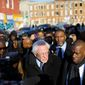 """Democratic presidential candidate Bernard Sanders in 2015 viewed a Baltimore neighborhood. """"You would think that you were in a Third World country"""" he reportedly said. (Associated Press photographs)"""
