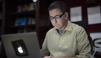 In this July 10, 2019, file photo, U.S. journalist Glenn Greenwald checks his news website at his home in Rio de Janeiro, Brazil. Greenwald, an attorney-turned-journalist who has long been a free-speech advocate, has found himself at the center of the first major test of press freedom under Brazil's President Jair Bolsonaro, who took office on Jan. 1 and has openly expressed nostalgia for Brazils 1964-1985 military dictatorship, a period when newspapers were censored and some journalists tortured. (AP Photo/Leo Correa) ** FILE **