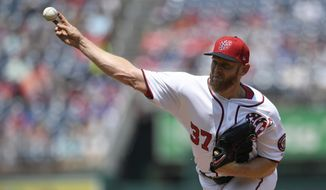 Washington Nationals starting pitcher Stephen Strasburg delivers during the first inning of a baseball game against the Los Angeles Dodgers, Sunday, July 28, 2019, in Washington. (AP Photo/Nick Wass)
