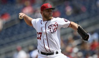 Washington Nationals starting pitcher Stephen Strasburg delivers a pitch during a baseball game against the Los Angeles Dodgers, Sunday, July 28, 2019, in Washington. (AP Photo/Nick Wass)